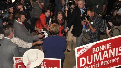 Media surround DA Bonnie Dumanis at U.S. Grant Hotel. Photo by Chris Stone