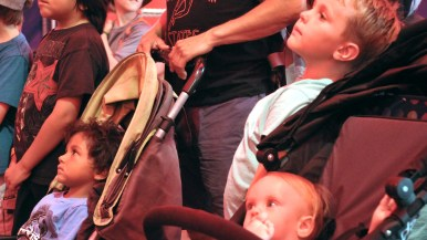 Children watch act in Worlds of Wonder sideshow at the San Diego County Fair.