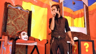 Sir Kade talks to Miss Spooky after guillotine trick in Worlds of Wonder sideshow at the San Diego County Fair.