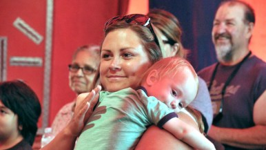 Mother comforts child after act in Worlds of Wonder sideshow at the San Diego County Fair.