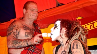 Red Stuart shows bulb glowing from Miss Electra in Worlds of Wonder tent at San Diego County Fair.