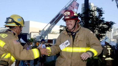 Members of the Heartland Fire Department exchange greetings as the stair climbing journal continued.