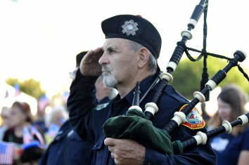 A member of the San Diego County Firefighters Pipes and Drums listens to the Pledge of Allegiance.