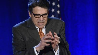 Texas Gov. Rick Perry grasps a point at RNC Winter meeting at the Hotel Del Coronado.