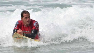 A surfer cruises in after competing.