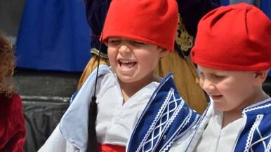 A young boy enjoys Greek dancing. Photo by Chris Stone