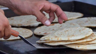 Pita breads were prepared for Gyros at the festival. Photo by Chris Stone