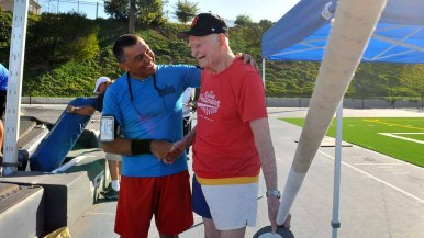 100-year-old Don Pellmann is greeted by a well-wisher before the pole vault. Photo by Chris Stone