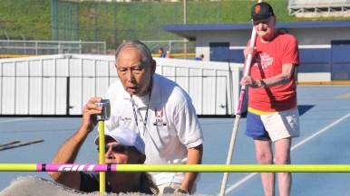 Pellman waits as officials double -check the height on the pole vault bar. Photo by Chris Stone