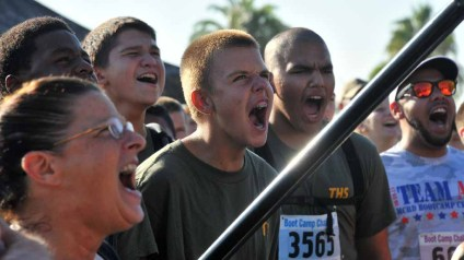 """Runners yell """"yes, sir"""" as they get a safety briefing before the race. Photo by Chris Stone"""