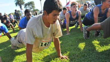 Runners shouted and did push-ups before the race. Photo by Chris Stone