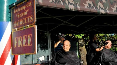 Some runners took advantage of free haircuts before the race. Photo by Chris Stone