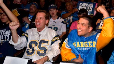 Chargers fans cheer their team during the NFL forum downtown. Photo by Chris Stone