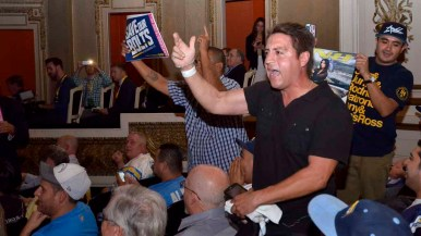 Marko Paul, a Chargers fan, shouts down a person who wanted the team to move to Los Angeles. Photo by Chris Stone