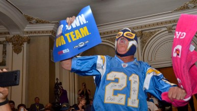 Renan Pozo, aka the Mask, shouts support for the Chargers. Photo by Chris Stone