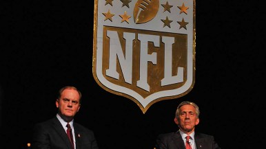 NFL representatives Chris Hardart and Eric Grubman listen to Charger fans at the forum. Photo by Chris Stone