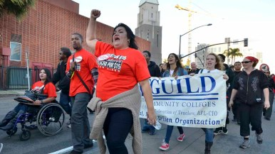 Workers and union members marched for an increase in the minimum wage. Photo by Chris Stone