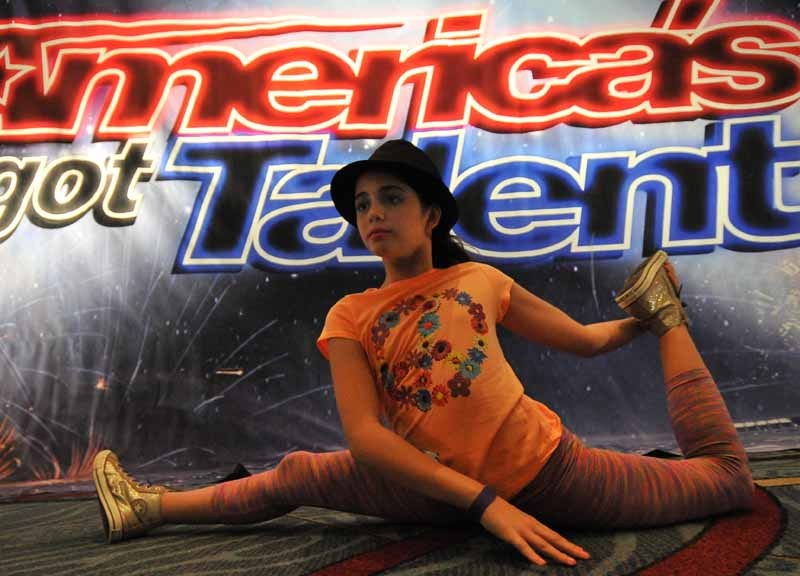 """Rebekah Ort, 10, of Carlsbad warms up before her dance-gymnastic performance for the """"America's Got Talent."""" auditions. Photo by Chris Stone"""
