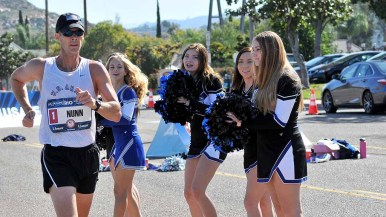 John Nunn is cheered by some of the 20 West Hills High School cheerleaders at the 50K Olympic Trials race walk. Photo by Ken Stone