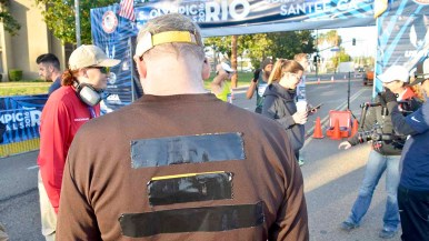 A race walk entrant tapes over brands not allowed by USA Track & Field at men's Olympic Trials 50K race walk. Photo by Ken Stone