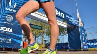 Knee locked, a walker passes the rolling start and finish stanchion at the Santee Olympic Trials. Photo by Ken Stone