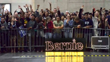 Bernie Sanders fans greet him as he enters convention center hall at 8:36 p.m. Photo by Chris Stone