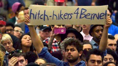 Many handmade signs greeted the Democratic presidential candidate. Photo by Chris Stone