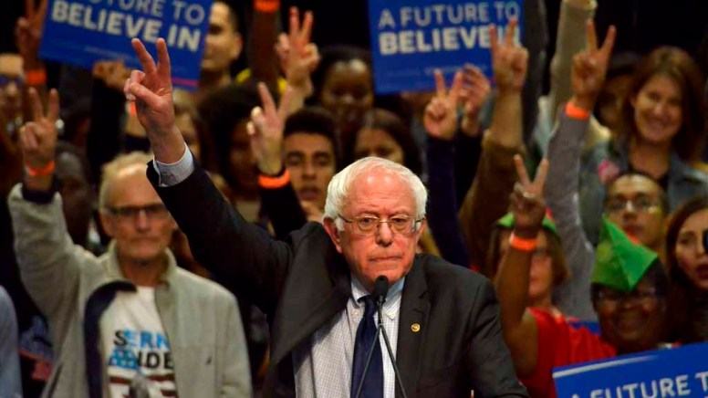 Bernie Sanders flashed peace symbol in solidarity with Belgium after terror attacks. Photo by Chris Stone