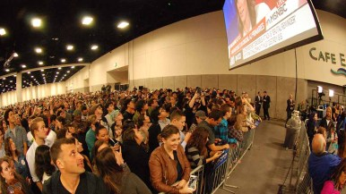 MSNBC and CNN results live feeds were shown in back of convention center hall, where Sanders also was shown. Photo by Ken Stone