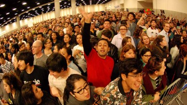 Thousands stand for Bernie Sanders in San Diego Convention Center. Photo by Ken Stone