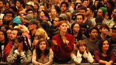 Audience members stood for hours, awaiting arrival of Bernie Sanders. Photo by Ken Stone