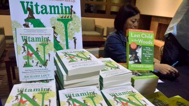 In foyer outside theater, Warwick's Bookstore in La Jolla sold copies of Richard Louv's latest book. Photo by Ken Stone
