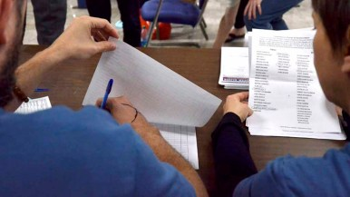 Three sets of volunteers tallied votes for potential Bernie Sanders delegates. Photo by Chris Stone