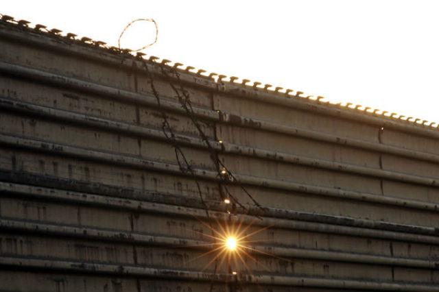 Border fence at sunset