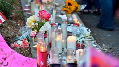 Candles, flowers and signs were left at the base of the Hillcrest Pride Flag at University Avenue and Normal Street. Photo by Chris Stone