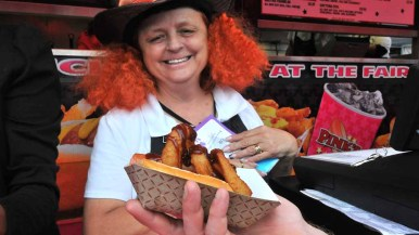 Pinks is offering Lord of the Rings, a hot dog wrapped in fried onion rings drizzled with barbecue sauce. Photo by Chris Stone