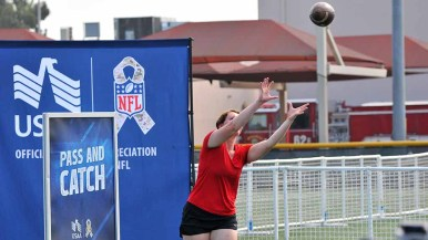 Pass and catch challenged many at the NFL Boot Camp. Photo by Chris Stone