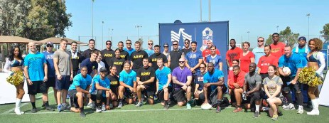 Military teams posed with Charger Girls at NFL Boot Camp at Marine Corps Air Station Miramar. Photo by Chris Stone