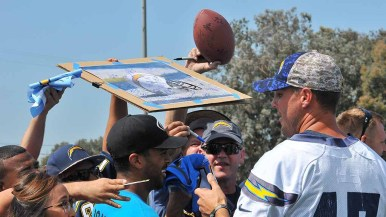 Phil Rivers signs autographs at NFL Boot Camp at Marine Corps Air Station Miramar. Photo by Chris Stone