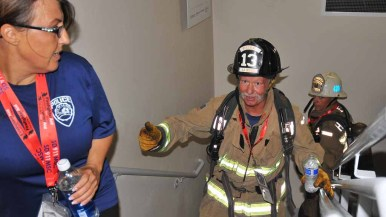 A Heartland La Mesa firefighter and La Mesa police officer make it to the 30th floor. Photo by Chris Stone