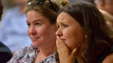 Two women listen to the presidential candidates at a debate watch at the Islamic Center of San Diego. Photo by Chris Stone