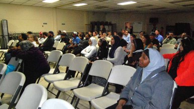 """A group of about 50 people including Muslims and Hispanics find a """"safe space"""" to watch the debate at the Islamic Center of San Diego. Photo by Chris Stone"""
