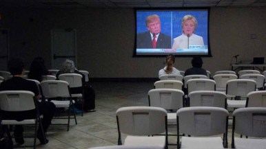 Seats were empty early in the debate at prayer time. About 50 people gathered afterward a the Islamic Center of San Diego. Photo by Chris Stone