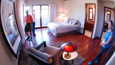 Tour-goers view bedroom at Avenida Manana home in La Jolla. Photo by Ken Stone
