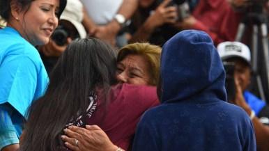 Maria Socorro Martinez Lopez of Mexico hugs her daughter Laura Avila. Photo by Chris Ston