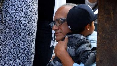 A relative of Elida Valdovinos Munoz shares precious moments with her son, Joshua Timothy Munoz. Photo by Chris Stone