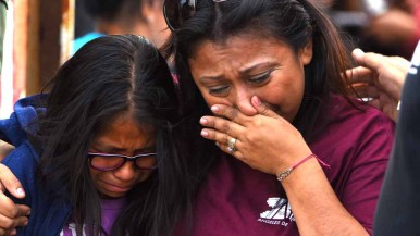 Laura Avila (right) and her daughter, Laura Vera Martinez, walk away from their loved ones after a three-minute visit. Photo by Chris Stone