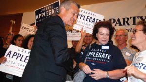 Retired Marine Col. Doug Applegate greets supporters at the Westin Hotel. Photo by Ken Stone