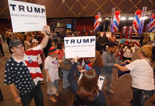 Donald Trump fans display signs at Golden Hall before the Republican's victory was assured. Photo by Ken Stone