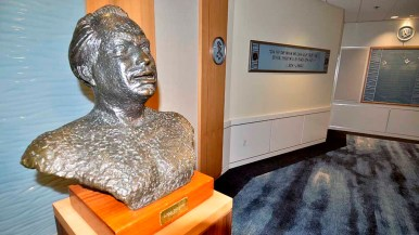 """Bust of L. Ron Hubbard and a wall quote: """"On the day we can fully trust each other, there will be peace on earth."""""""